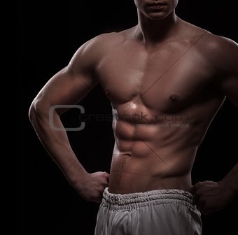 athletic man torso over black