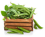 Green peas in wooden box