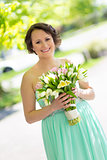 Happy bride with wedding bouquet.