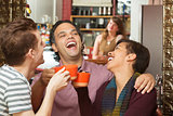 Happy Group with Coffee Cups Laughing