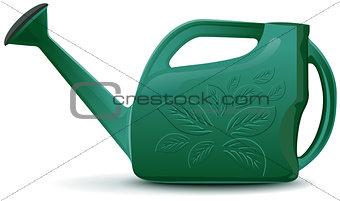Green plastic garden watering can