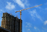 High-rise building under construction and crane