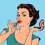 Girl paints lips with lipstick cosmetics beauty perfumes pop art