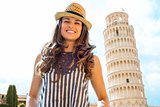 Happy female tourist smiling near Leaning Tower of Pisa