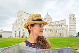 Woman wearing hat in profile holding map in Pisa