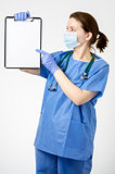 Doctor pointing at blank clipboard