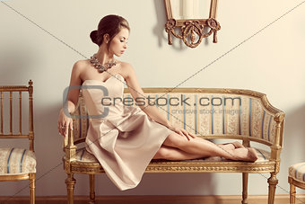 aristocratic girl on sofa