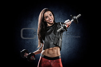 portrait of pretty young girl exercising with weights