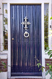 Painted violet door with white handle