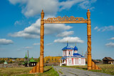 Wooden gate and Rise chapel. Russia