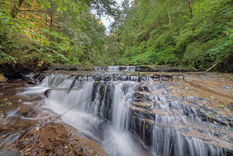 Tiered Cascading Waterfall over Ledge at Sweet Creek Falls Trail