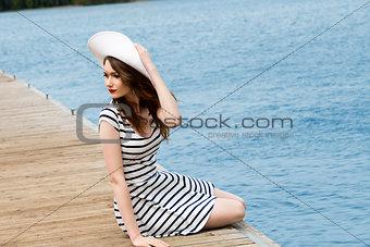 trendy girl near blue sea
