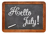 Hello July sign on blackboard