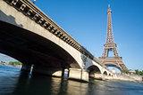The Eiffel Tower and bridge over Seine River in Paris