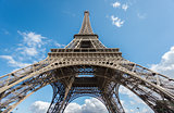 The Eiffel Tower over blue sky, bottom-up view