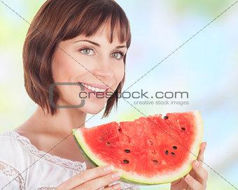 Beautiful woman eating watermelon