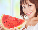 Happy woman eat watermelon