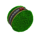 Road around a grassy globe