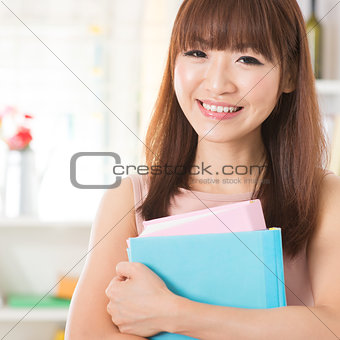 Asian girl with textbooks