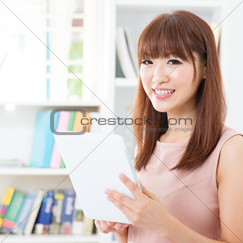 Asian female using tablet