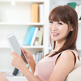Asian girl using tablet pc