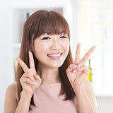 Asian girl showing v hands sign