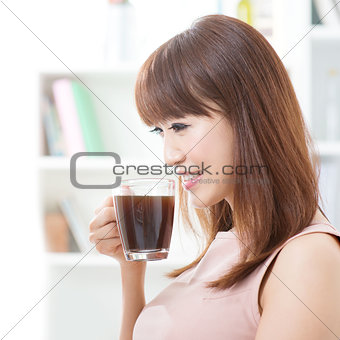 Asian girl drinking coffee
