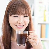 Asian girl enjoying coffee