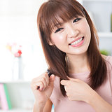 Asian girl brushing hair