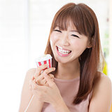 Asian girl eating cupcake