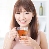 Asian girl enjoying tea