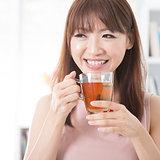 Asian girl drinking tea
