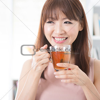 Asian girl drinking tea