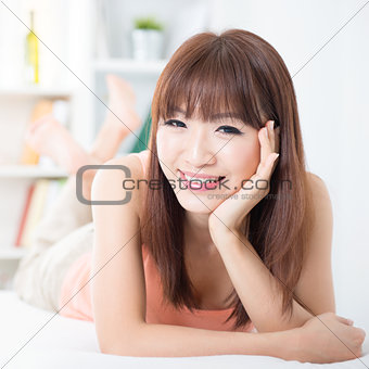 Asian girl resting on bed