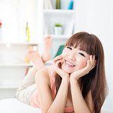 Happy Asian girl at home