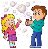 Children playing with bubble kit theme 1
