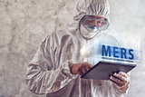 Medical Scientist Reading About MERS Virus on Figital Tablet Com