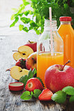 fruit juice, ripe apples and strawberries