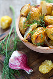 Baked potatoes, dill and garlic.