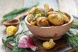 Baked potatoes with fresh dill.