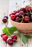 Bowl with ripe red cherries.