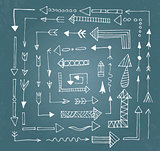 Hand drawn arrow icons set on blue chalk board