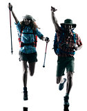 couple trekker trekking running happy silhouette