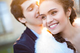 Close portrait of happy wedding couple