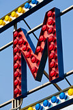 M letter circus neon sign