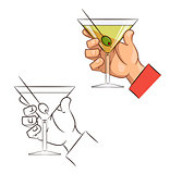 Glass of martini with olive in hand