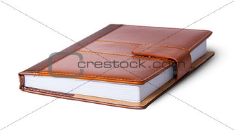 Closed notebook in leather cover