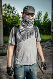 Man covering face with a scarf. Terrorism concept.
