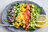 Salmon, avocado, corn, cucumber and onion salad