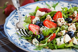 Arugula, strawberry, blueberry and blue cheese salad